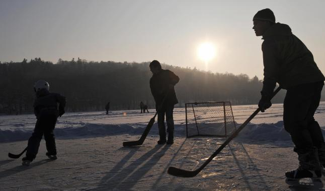 Young ice-hockey players enjoy a game on